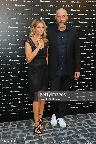 Actress Isabella Ferrari and Max Cardelli attend the 'Isabella Ferrari Forma/Luce' cocktail party at Horti Sallustiani on July 13, 2014 in Rome,...