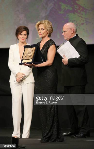 Actress Isabella Ferrari poses on stage with Best Actress Award for the movie 'E la chiamano estate' during the Awards Ceremony at the 7th Rome Film...