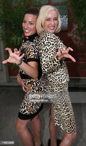 Actress Isabella HuebnerSchmoelzer and colleague Julia Dahmen pose during a reception of the Bavaria film company on June 26 in Munich Germany