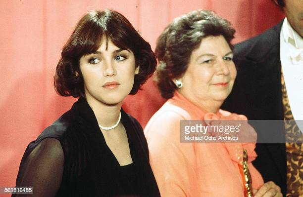 Actress Isabelle Adjani poses backstage with Verna Fields winner of Best Film Editing award during the 48th Academy Awards at Dorothy Chandler...