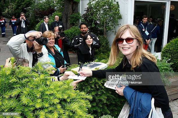 Actress Isabelle Carre signs autographs during Day Fourteen Women single's Final of the 2016 French Tennis Open at Roland Garros on June 4 2016 in...
