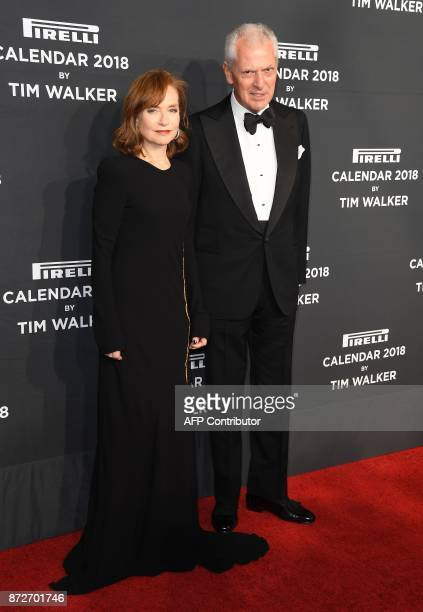 Actress Isabelle Huppert and Chief Executive Officer of Pirelli C SpA Marco Tronchetti Provera attend the 2018 Pirelli Calendar Launch Gala at...