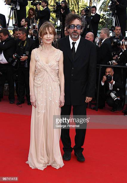 Actress Isabelle Huppert and director and president of the jury Tim Burton attend the premiere of 'Biutiful' held at the Palais des Festivals during...