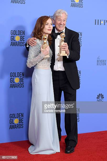 Actress Isabelle Huppert and filmmaker Paul Verhoeven pose in the press room during the 74th Annual Golden Globe Awards at The Beverly Hilton Hotel...