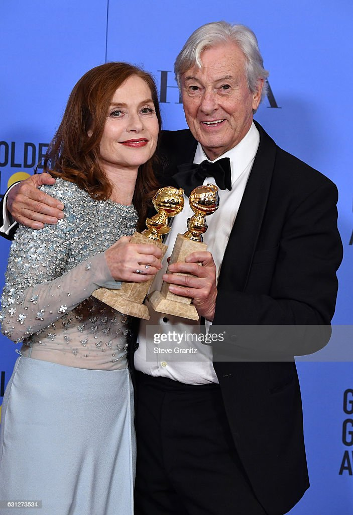Actress Isabelle Huppert (L) and filmmaker Paul Verhoeven pose in the press room during the 74th Annual Golden Globe Awards at The Beverly Hilton Hotel on January 8, 2017 in Beverly Hills, California.