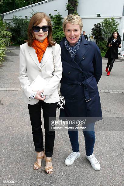 Actress Isabelle Huppert and journalist Elise Lucet attend Day Fourteen Women single's Final of the 2016 French Tennis Open at Roland Garros on June...