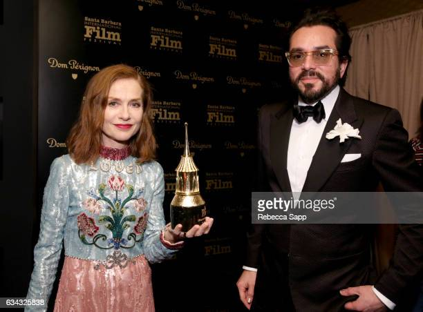 Actress Isabelle Huppert and SBIFF Executive Director Roger Durling pose backstage at the Montecito Award during the 32nd Santa Barbara International...
