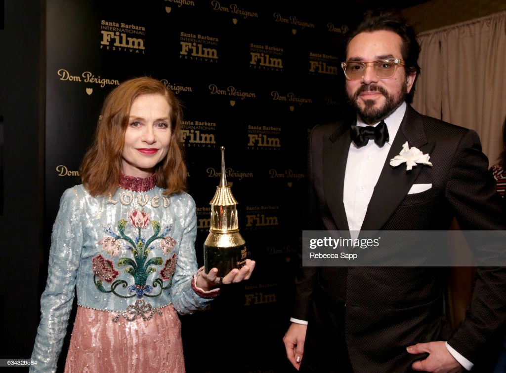 Actress Isabelle Huppert and SBIFF Executive Director Roger Durling pose backstage at the Montecito Award during the 32nd Santa Barbara International Film Festival at the Arlington Theatre on February 8, 2017 in Santa Barbara, California.
