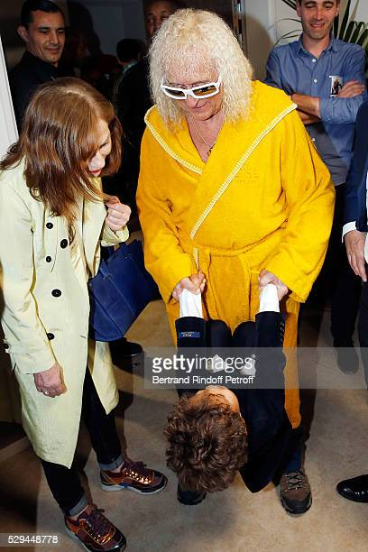 Actress Isabelle Huppert Singer Michel Polnareff and his Son Louka attend Michel Polnareff New Tour in France at AccorHotels Arena on May 08 2016 in...