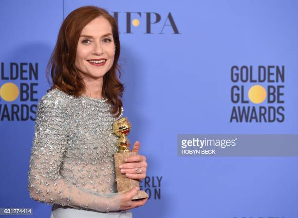 TOPSHOT Actress Isabelle Huppert winner of Best Actress in a Motion Picture Drama for 'Elle' poses in the press room during the 74th Annual Golden...