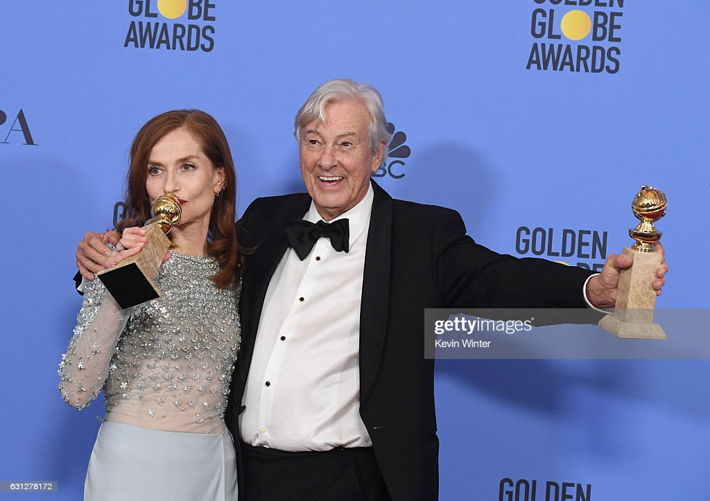 Actress Isabelle Huppert (L), winner of Best Actress in a Motion Picture - Drama for 'Elle,' and director Paul Verhoeven, winner of Best Foreign Language Film for 'Elle,' pose in the press room during the 74th Annual Golden Globe Awards at The Beverly Hilton Hotel on January 8, 2017 in Beverly Hills, California.