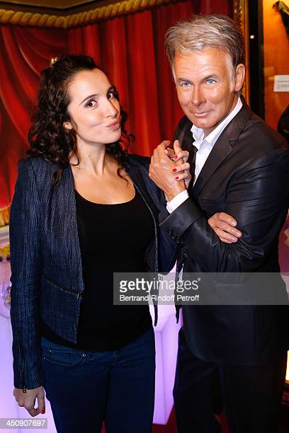 Actress Isabelle Vitari with Franck Dubosc waxwork attends Coca Cola Christmas Father Waxwork Unveiling Event at Musee Grevin on November 20, 2013 in...