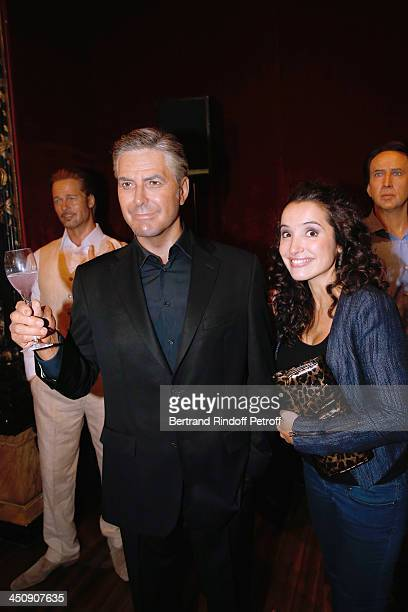 Actress Isabelle Vitari with George Clooney waxwork attends Coca Cola Christmas Father Waxwork Unveiling Event at Musee Grevin on November 20 2013 in...