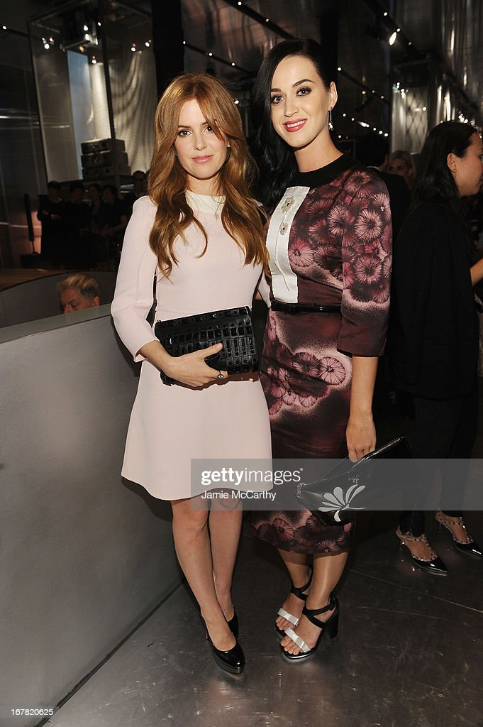 Actress Isla Fisher and singer Katy Perry, both wearing Prada, attend Catherine Martin And Miuccia Prada Dress Gatsby Opening Cocktail on April 30, 2013 in New York City.