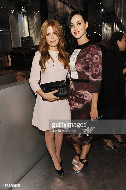 Actress Isla Fisher and singer Katy Perry, both wearing Prada, attend Catherine Martin And Miuccia Prada Dress Gatsby Opening Cocktail on April 30,...