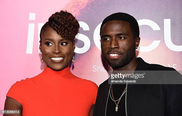 Actress Issa Rae and actor Y'Lan Noel arrive at the premiere of HBO's 'Insecure' at the Nate Holden Performing Arts Center on October 6 2016 in Los...