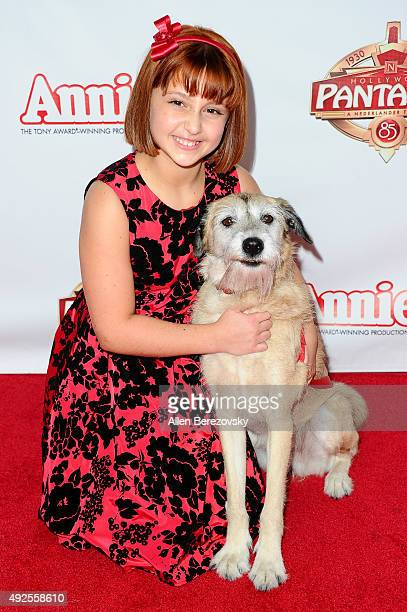 Actress Issie Swickle and dog Macy attend the Premiere of Annie at the Hollywood Pantages Theatre on October 13 2015 in Hollywood California