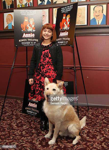 Actress Issie Swickle and Sandy attend the Annie Cast Photocall at Sardi's on December 4 2015 in New York City
