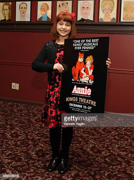 Actress Issie Swickle attends the Annie Cast Photocall at Sardi's on December 4 2015 in New York City