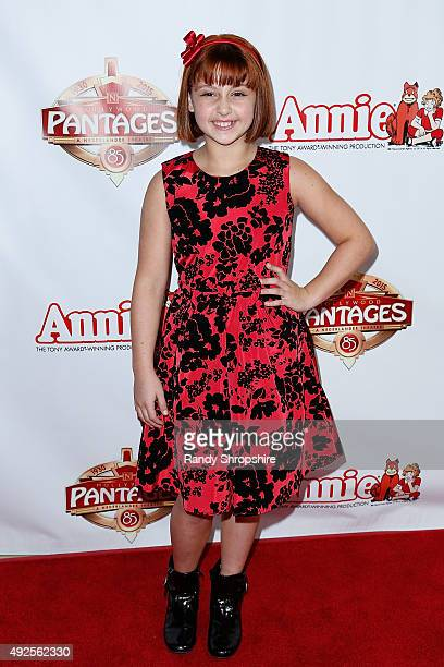 Actress Issie Swickle attends the premiere of Annie at the Hollywood Pantages Theatre on October 13 2015 in Hollywood California