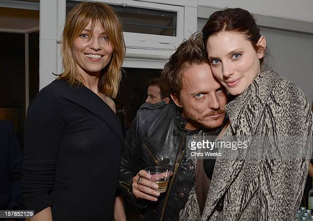 Actress Ivana Milicevic photographer Randall Slavin and actress April Bowlby attends the opening of Wetdreams at Gallery Brown on December 6 2012 in...