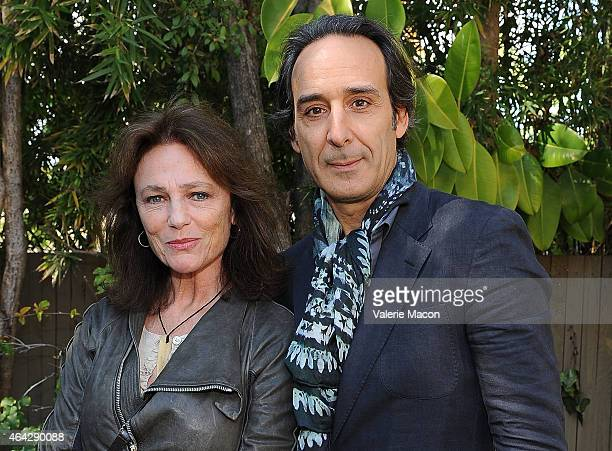 Actress Jacqueline Bisset and composer Alexandre Desplat attends The Consul General Of France, Mr. Axel Cruau, Honors The French Nominees For The...