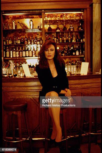Actress Jacqueline Bisset Sitting in Bar