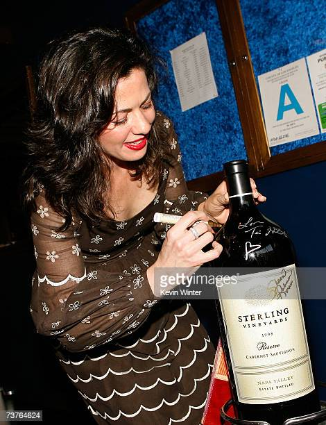Actress Jacqueline Mazarella signs the Magnum of Sterling Wine bottle donated for the silent auction during the 6th Annual Comedy For A Cure hosted...