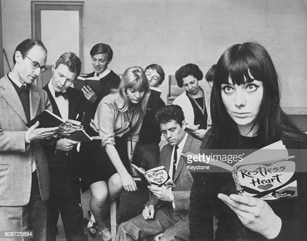 Actress Jacqueline Pearce reading a copy of the play 'The Restless Heart' with a group of students during rehearsals at the start of term at the...