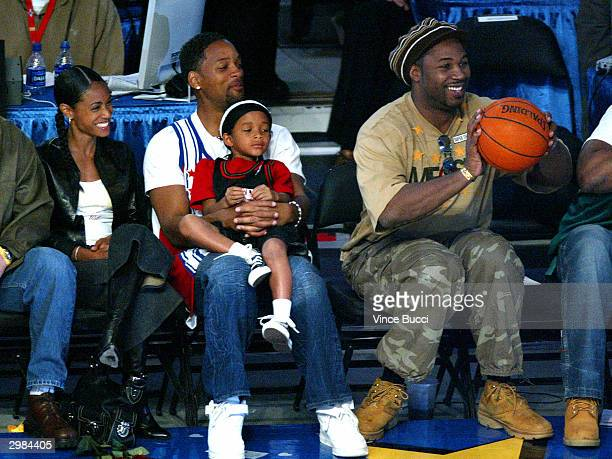 Actress Jada Pinkett Smith actor Will Smith and son Jaden and boxer Lennox Lewis watch the slamdunk contest during the NBA AllStar Saturday Night...