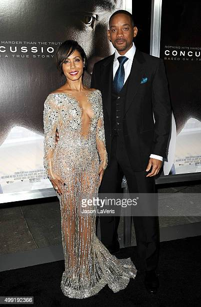 Actress Jada Pinkett Smith and actor Will Smith attend a screening of Concussion at Regency Village Theatre on November 23 2015 in Westwood California