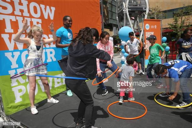 Actress Jade Pettyjohn and Emcee Albert Lawrence at UNICEF Kid Power Los Angeles event at Microsoft Square on May 13 2017 in Los Angeles California