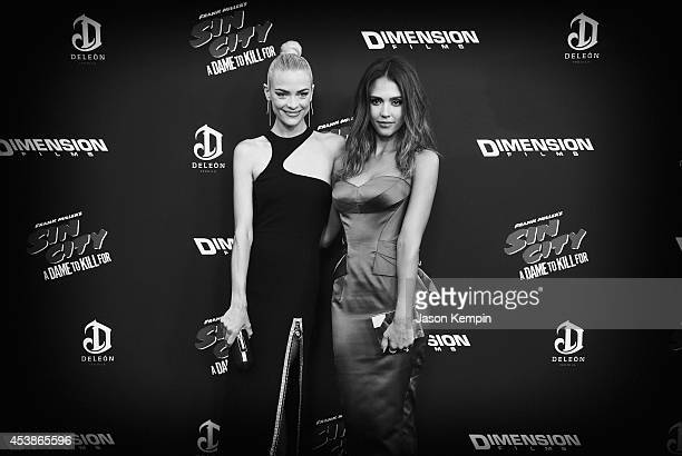 Actress Jaime King and actress Jessica Alba attend the premiere of Sin City A Dame To Kill For at TCL Chinese Theatre on August 19 2014 in Hollywood...