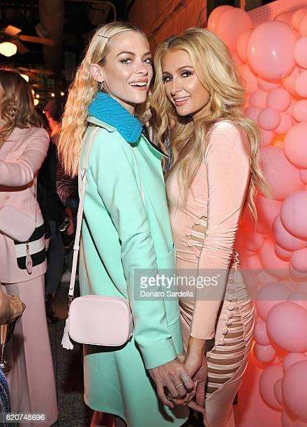 Actress Jaime King and businesswoman Paris Hilton attend Poppy Jamie Suki Waterhouse Leo Seigal and Cade Hudson celebration of the launch of POP SUKI...