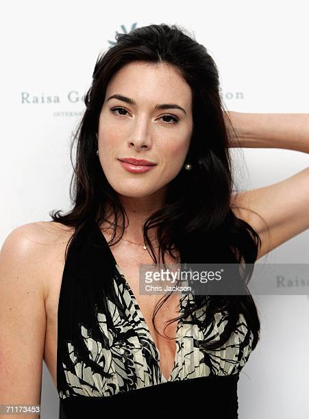 Actress Jaime Murray poses for a photograph as she arrives for the Raisa Gorbachev Foundation Launch Party On June 10, 2006 in Althrop, England. The...