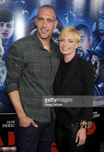 Actress Jaime Pressly and Hamzi Hijazi arrive at the Los Angeles premiere of A Haunted House 2 at Regal Cinemas LA Live on April 16 2014 in Los...