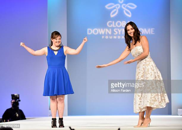 Actress Jamie Brewer walks the runway with actress Minka Kelly at 'Be Beautiful Be Yourself' Global Down Syndrome Foundation Fashion Show 2015 held...