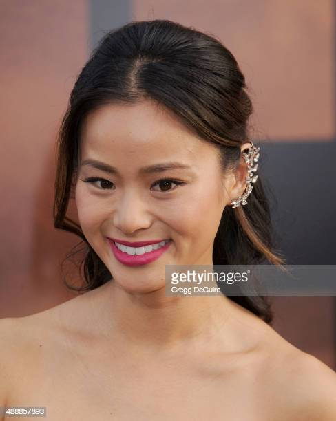 """Actress Jamie Chung arrives at the Los Angeles premiere of """"Godzilla"""" at Dolby Theatre on May 8, 2014 in Hollywood, California."""