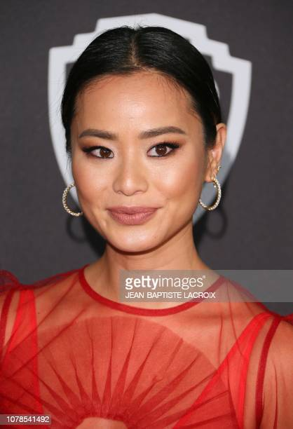 US actress Jamie Chung arrives for the Warner Bros and In Style 20th annual post Golden Globes party at the Oasis Courtyard of the Beverly Hilton...