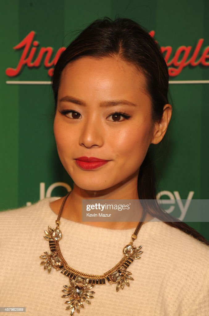 Actress Jamie Chung attends a surprise holiday event and performance by Blake Shelton, with the USO Show Troupe, virtual carolers and spectacular 3D projection mapping over the Manhattan Mall courtesy of JCPenney on December 19, 2013 at Greely Square Park in New York City.
