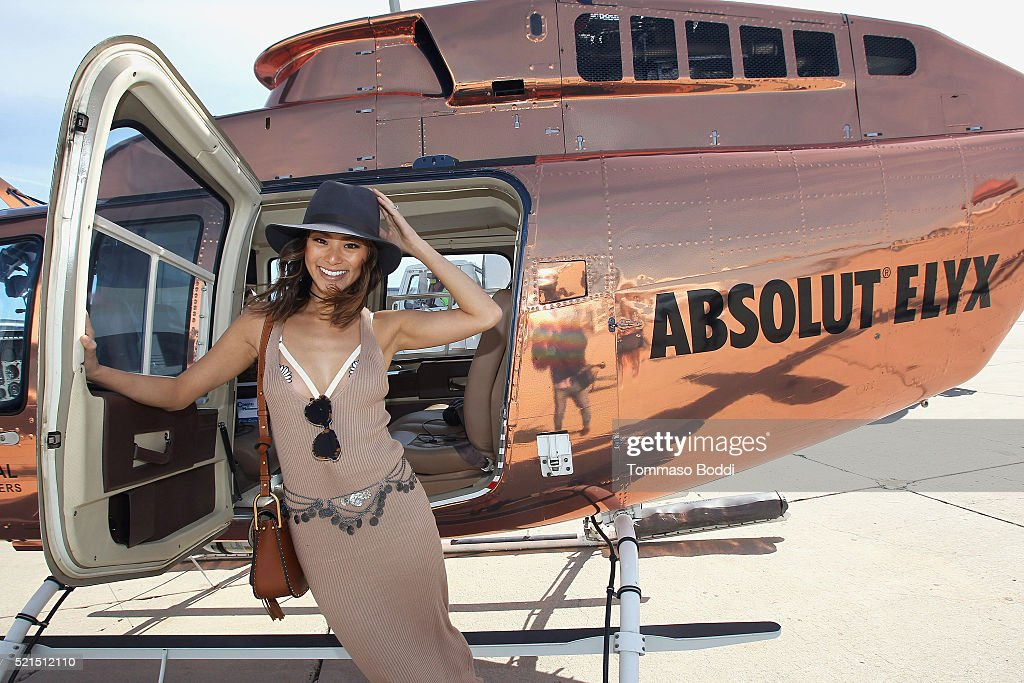 Actress Jamie Chung Boards The Absolut Elyx Copper Chopper To Coachella at Atlantic Aviation Santa Monica on April 15, 2016 in Santa Monica, California.
