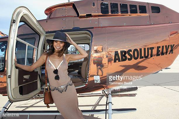 Actress Jamie Chung Boards The Absolut Elyx Copper Chopper To Coachella at Atlantic Aviation Santa Monica on April 15 2016 in Santa Monica California