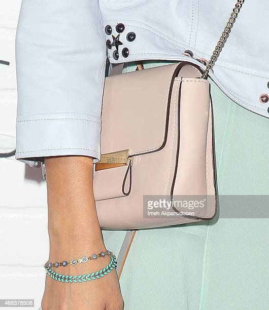 Actress Jamie Chung purse detail attends the JustFab Apparel Launch Event at Sunset Tower on April 1 2015 in West Hollywood California