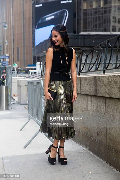 Actress Jamie Chung wears a metallic pleated skirt at the Cushnie et Ochs show at The Dock at Moynihan Station on September 9 2016 in New York City