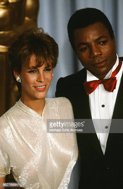 Actress Jamie Lee Curtis poses with actor Carl Weathers backstage during the 55th Academy Awards at Dorothy Chandler Pavilion Los Angeles California