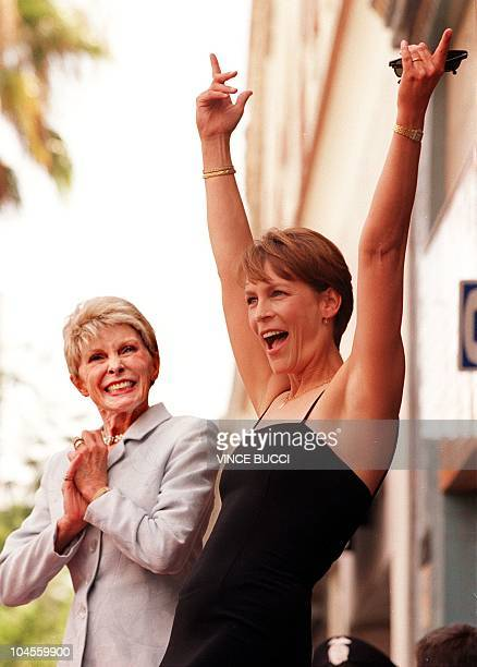 US actress Jamie Lee Curtis reacts as she is honored with a star on the Walk of Fame as her mother veteran actress Janet Leigh watches during a...