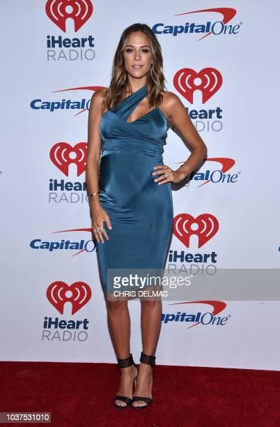 US actress Jana Kramer arrives in the press room for the iHeartRadio Music Festival in Las Vegas Nevada on September 21 2018