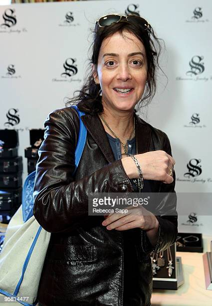 Actress Jane Adams poses at the Simmons Jewelry Company display during the HBO Luxury Lounge in honor of the 67th annual Golden Globe Awards held at...