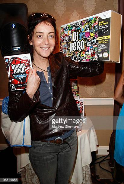 Actress Jane Adams poses with the Activision display during the HBO Luxury Lounge in honor of the 67th annual Golden Globe Awards held at the Four...