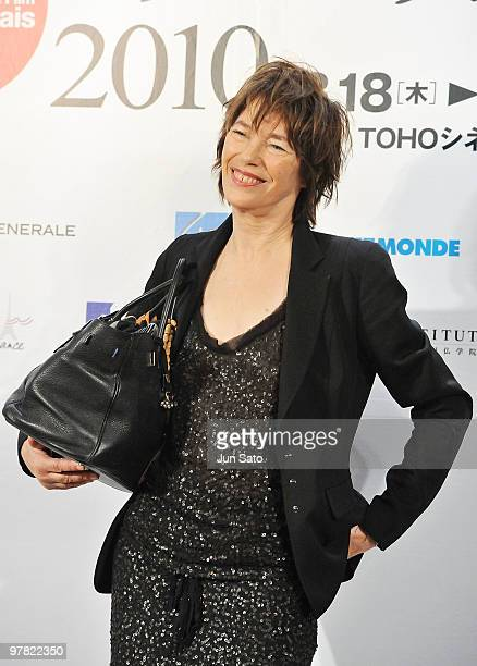 Actress Jane Barkin holds her Hermes Birkin handbag during the France Film Festival 2010 press conference at Roppongi Hills on March 18 2010 in Tokyo...